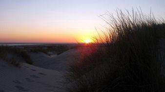 sunset over the dunes in borkum