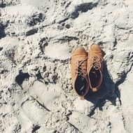 leather shoes on a sandy beach