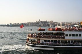 ship with tourists on sea in view of city, turkey, istanbul