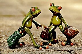 Vintage of the frog figures with the luggage