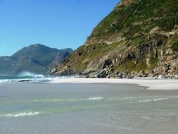 white sand beach at rocky coast, south africa, noordhoek