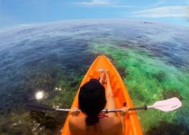 man in a kayak over the reef