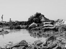 black and white photo of a rocky beach