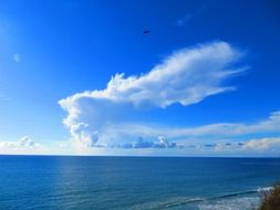 white clouds over seascape