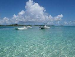 boats in the clear water of the caribbean sea
