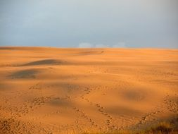 human footprints in the sand dunes