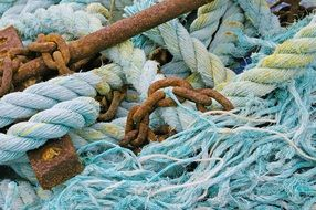 Blue ropes and rusty anchor on a fishing boat