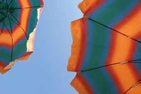 colored parasols against the blue sky
