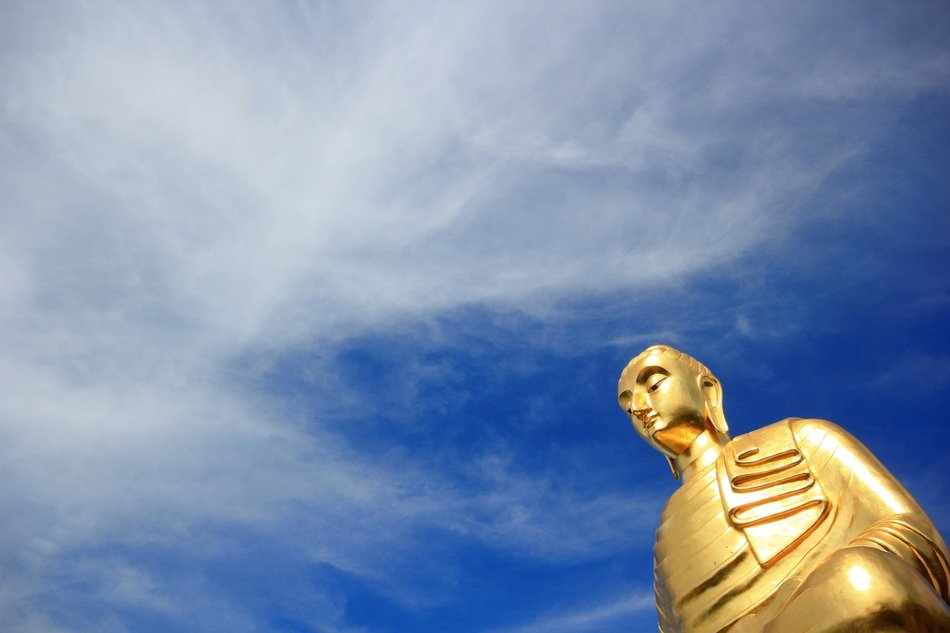 Golden statue and blue sky