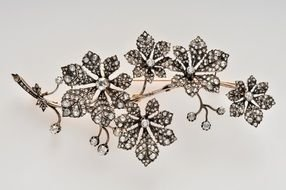 brooch in the shape of a floral branch with diamonds