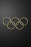 gold olympic rings on a black background