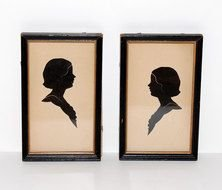 silhouettes of portraits in frames as a graphic illustration