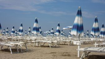 parasols and sun loungers on a beach