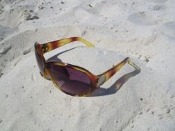 shades sunglasses sand beach