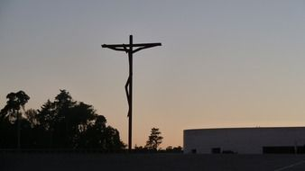 silhouette of the crucifix at sunset in portugal