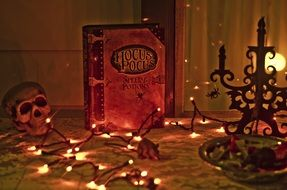 hocus pocus book and halloween decorations, still life