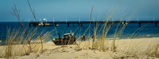 fishing boat on the beach of the Baltic Sea on a sunny day