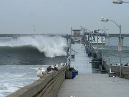 huge waves over the ocean pier