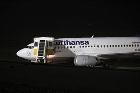 white aircraft by lufthansa airliner