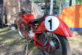 red retro motorbike at camping