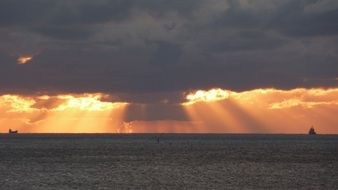 sun rays through the clouds over the north sea