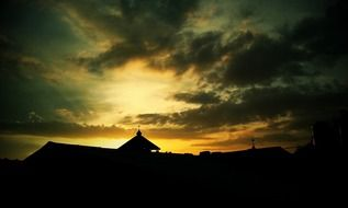 silhouette of a mosque at dusk
