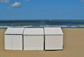 beach huts on a sandy beach on the north sea in belgium