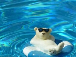 ceramic figure of a polar bear swimming in the pool