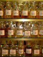 glass bottles on the shelves in the pharmacy