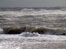 grey foamy waves of stormy north sea