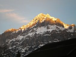 golden peaks of mountains at sunrise in Switzerland