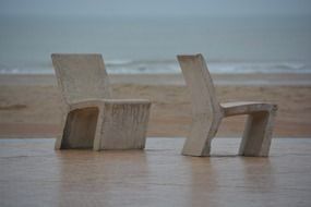 Stone chairs sea rest duo beach