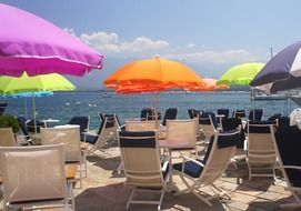 chaise lounges and colorful umbrellas on the beach
