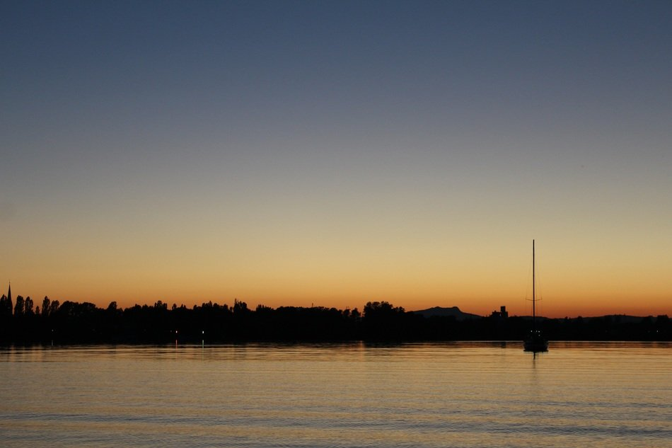 calm sunset over lake constance