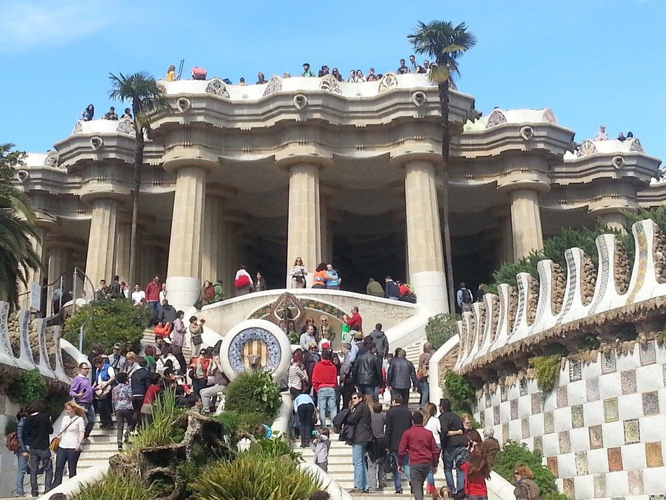 tourists in park guell barcelona spain