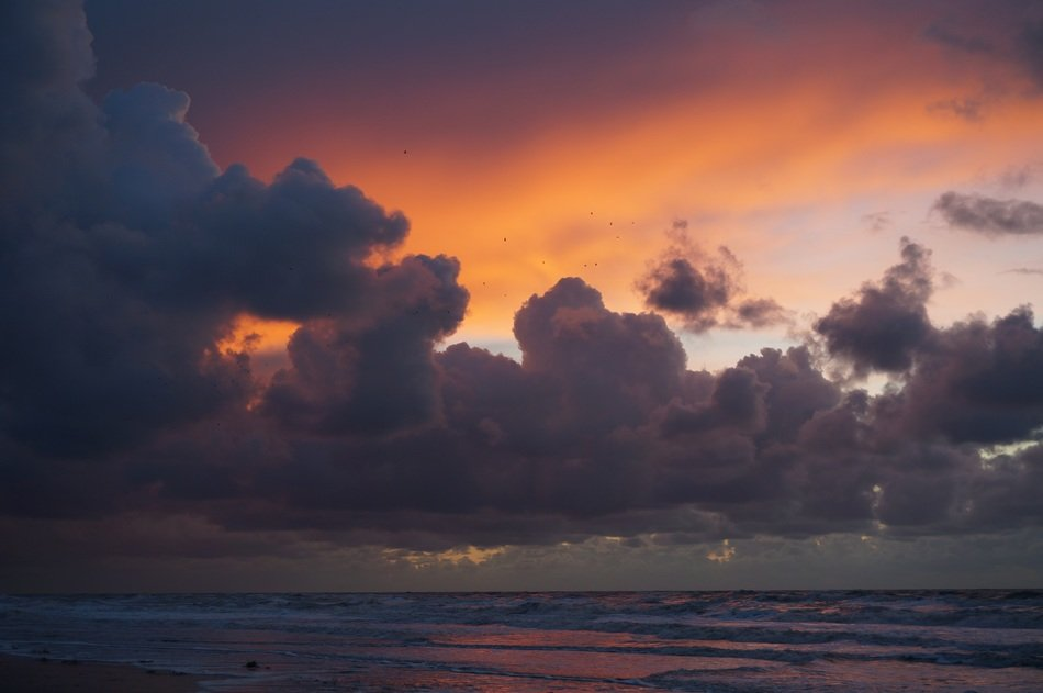 storm clouds over the ocean coast at sunset