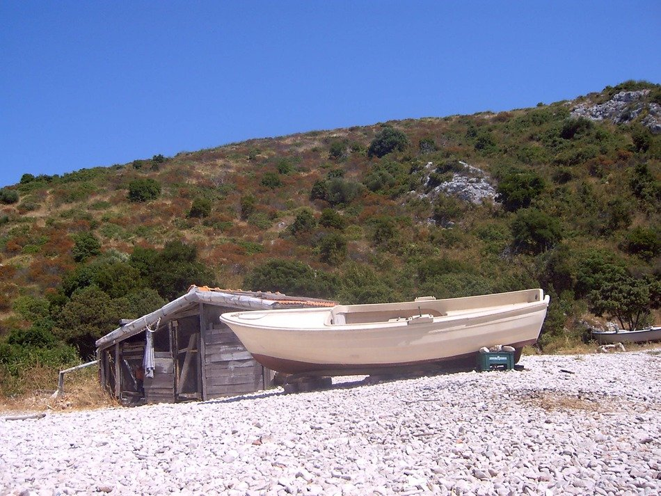 fishing boat on sandy beach