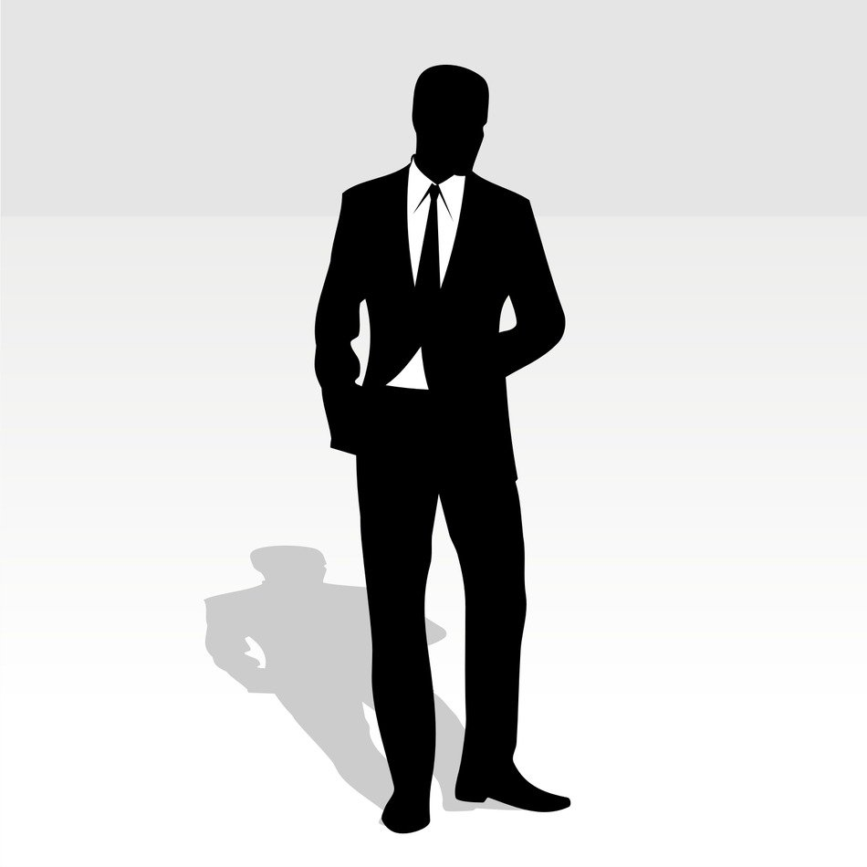 silhouette of a man in a black suit