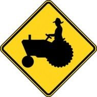 worker on a tractor on a yellow sign