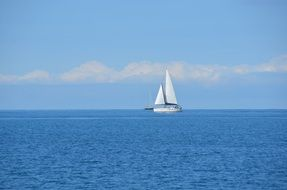 sailboat on the blue sea surface