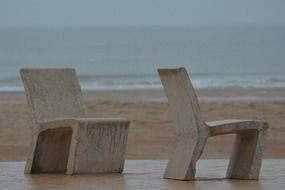 stone chairs on the beach