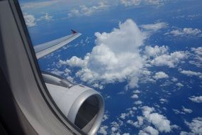 aircraft engine and clouds from an airplane window