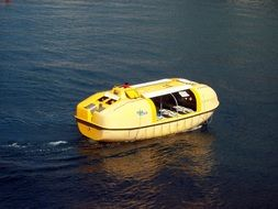 yellow life boat on water