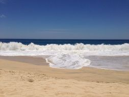 blue sky, white waves and yellow beach, mexico, cabo san lucas