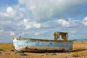 abandoned fishing boat on the shore