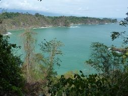 scenic bay at rocky coast, costa rica, manuel antonio