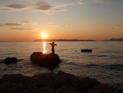 girl silhouette on sunset background in croatia
