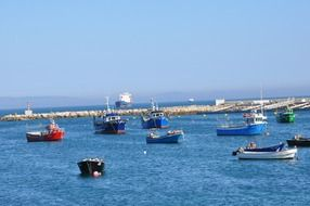 fishing boats in the bay in Cascais, Portugal