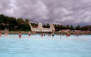 people relax in the water park on the canary islands
