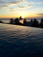 sunset over the pool in Thailand